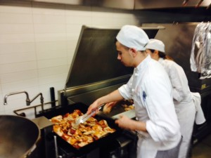Vitor working on the BBQ chicken