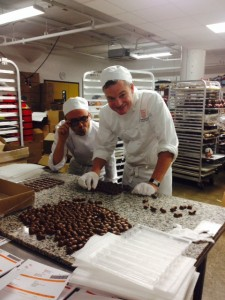 Stewart doing quality control on the champagne infused chocolates