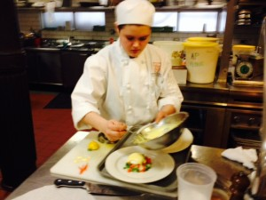 Emma plating the poached eggs