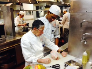 Dean Chef Candy gives Pablo some trussing help