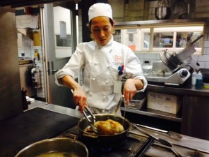 Miyako searing the dark meats of the chicken before putting in the oven
