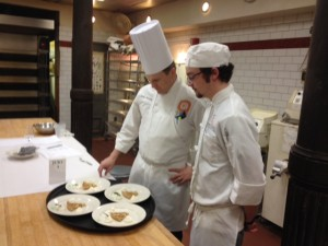 Chef John evaluating Spencer's creations